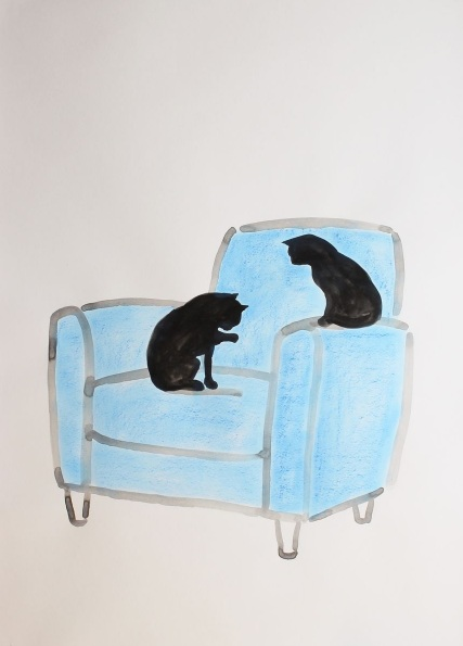 Two cats on a blue chair
