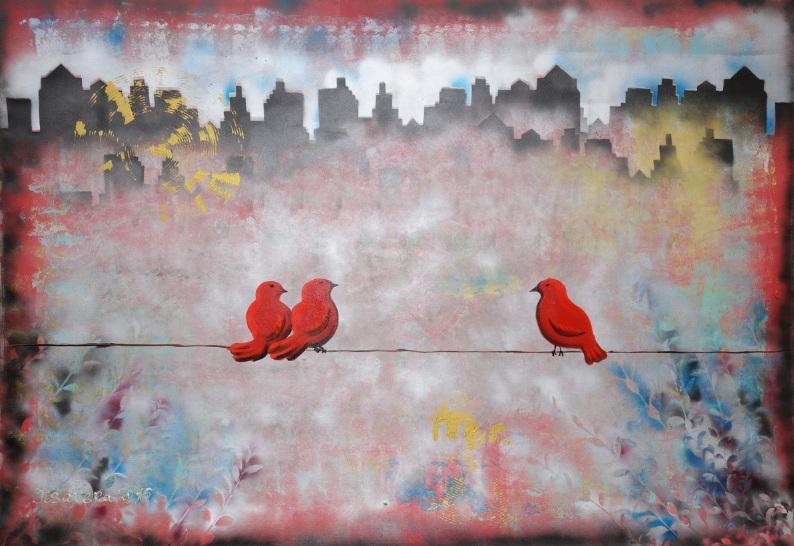 Ksavera-3 Red birds on a wire in cityscape